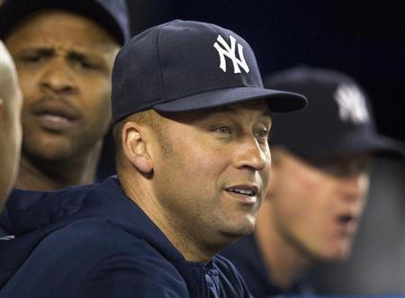 New York Yankees Derek Jeter watches play from the dugout during the seventh inning of their American League MLB baseball game against the Toronto Blue Jays in Toronto September 18, 2013. REUTERS/Fred Thornhill