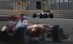 Red Bull Formula One driver Sebastian Vettel of Germany (R) drives during the second practice session of the Abu Dhabi F1 Grand Prix at the Yas Marina circuit on Yas Island, November 1, 2013. REUTERS/Ahmed Jadallah