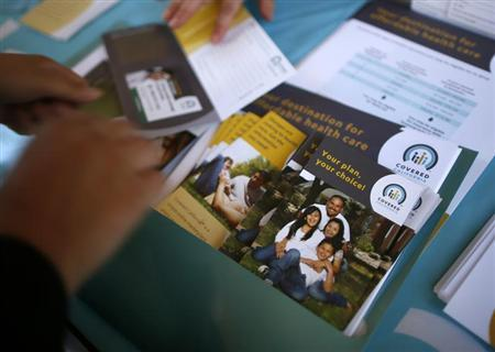 People sign up for health insurance information at a Covered California event which marks the opening of the state's Affordable Healthcare Act, commonly known as Obamacare, health insurance marketplace in Los Angeles, California, October 1, 2013.REUTERS/Lucy Nicholson