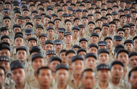 Inmates listen to a speech at Taiyuan No.1 prison in Taiyuan, Shanxi province September 1, 2010. REUTERS/Stringer