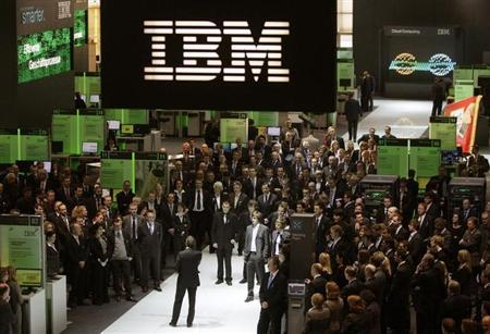Employees follows a speech at the booth of IBM at CeBIT computer fair in Hanover March 3, 2009. REUTERS/Hannibal Hanschke/Files