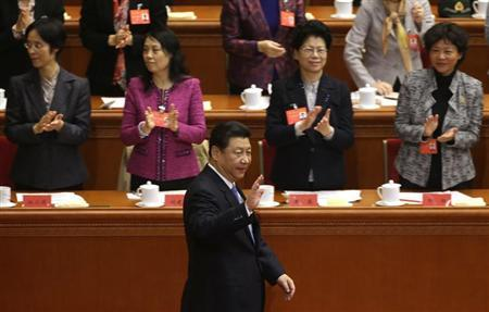 China's President Xi Jinping waves to delegates as he arrives for the opening ceremony of the 11th National Women's Congress at the Great Hall of the People in Beijing, October 28, 2013. REUTERS/Jason Lee