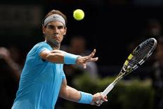 Rafael Nadal of Spain eyes the ball before returning to compatriot Marcel Granollers at the Paris Masters men's singles tennis tournament at the Palais Omnisports of Bercy in Paris, October 30, 2013. REUTERS/Charles Platiau