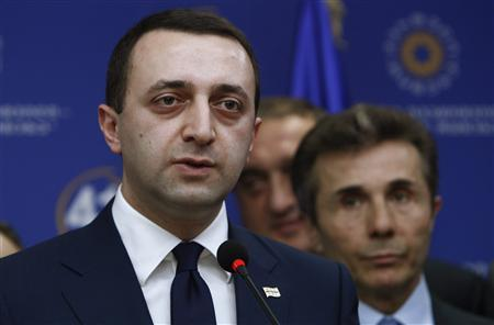 Georgia's Interior Minister Irakly Garibashvili speaks during a news conference as Prime Minister Bidzina Ivanishvili looks on in Tbilisi, November 2, 2013. Georgia's prime minister on Saturday proposed his close ally, Garibashvili, to succeed him when he steps down in the next few weeks. REUTERS/David Mdzinarishvili