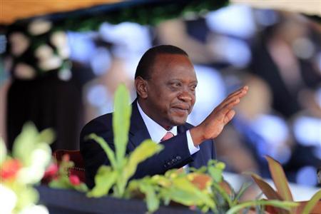 Kenya's President Uhuru Kenyatta reacts as he attends Mashujaa (Heroes) Day at the Nyayo National Stadium in capital Nairobi October 20, 2013. REUTERS/Noor Khamis