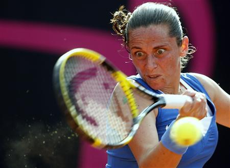 Italy's Roberta Vinci hits a return to Russia's Alexandra Panova during their Fed Cup World Group women's tennis final match in Cagliari, November 2, 2013. REUTERS/Alessandro Bianchi