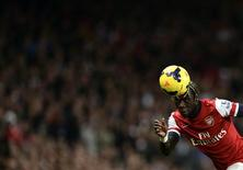 Arsenal's Bacary Sagna heads the ball during their English Premier League soccer match against Liverpool at the Emirates stadium in London November 2, 2013. REUTERS/Dylan Martinez