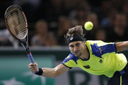 David Ferrer of Spain hits a return to compatriot Rafael Nadal in their semi-final match at the Paris Masters men's singles tennis tournament at the Palais Omnisports of Bercy in Paris, November 2, 2013. REUTERS/Gonzalo Fuentes