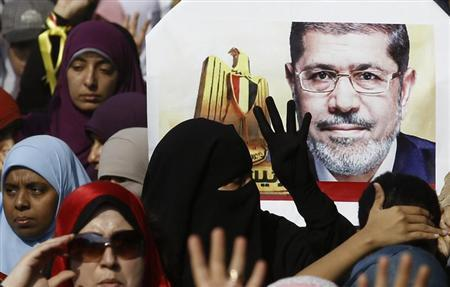Supporters of the Muslim Brotherhood and ousted Egyptian President Mohamed Mursi take part in a protest against the military and interior ministry in the southern suburb of Maadi, on the outskirts of Cairo November 1, 2013. REUTERS/Amr Abdallah Dalsh