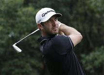Dustin Johnson of the U.S. tees off on the third hole during the final round of the WGC-HSBC Champions golf tournament in Shanghai November 3, 2013. REUTERS/Aly Song