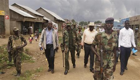 Congolese leaders of the M23 rebels are escorted in Bunagana, in eastern Democratic Republic of Congo, September 8, 2013. REUTERS/Kenny Katombe