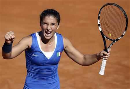 Italy's Sara Errani celebrates after winning a match against Russia's Alisa Kleybanova during their Fed Cup World Group final tennis match in Cagliari, November 3, 2013. REUTERS/Alessandro Bianchi