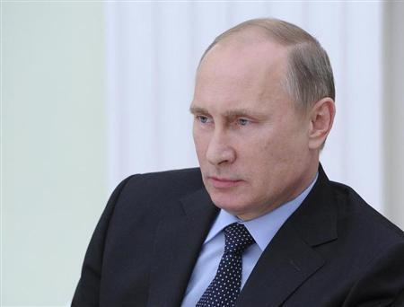 Russian President Vladimir Putin looks on during a meeting with Serbian President Tomislav Nikolic in Moscow's Kremlin October 30, 2013. REUTERS/Michael Klimentyev/RIA Novosti/Kremlin