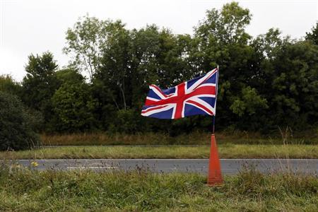 An Union Jack flag flutters along the A31 near New Arlesford, southern England September 6, 2013. REUTERS/Stefan Wermuth/Files