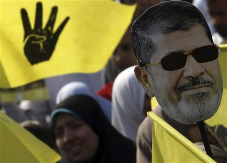 A supporter of the Muslim Brotherhood and ousted Egyptian President Mohamed Mursi takes part in a protest against the military and interior ministry in the southern suburb of Maadi, on the outskirts of Cairo November 1, 2013. REUTERS/Amr Abdallah Dalsh