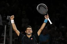 Novak Djokovic of Serbia reacts after defeating David Ferrer of Spain in the men's singles final match at the Paris Masters men's singles tennis tournament at the Palais Omnisports of Bercy in Paris, November 3, 2013. REUTERS/Gonzalo Fuentes