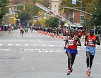 Geoffrey Mutai and Stanley Biwott (R), both of Kenya, make their way through the borough of Manhattan during the New York City Marathon in New York, November 3, 2013. REUTERS/Adam Hunger