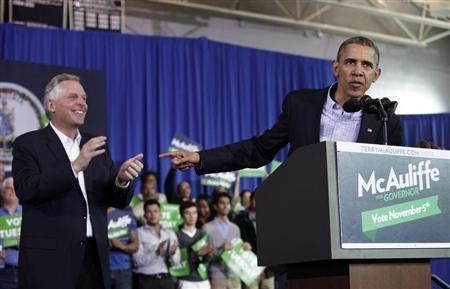 U.S. President Barack Obama delivers remarks at a campaign event for Terry McAuliffe (L) for Governor in Arlington, Virginia, November 3, 2013. REUTERS/Yuri Gripas