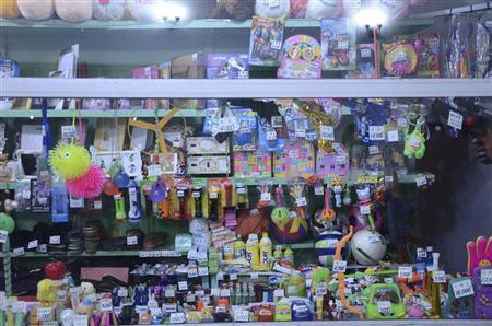 Toys and other small items are tagged with their prices based on grey market rates in a shop in downtown Pyongyang in this recent, undated handout picture. REUTERS/Handout