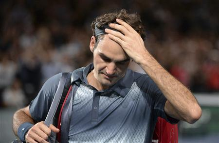 Roger Federer of Switzerland leaves the court after being defeated by Novak Djokovic of Serbia in their semi-final match at the Paris Masters men's singles tennis tournament at the Palais Omnisports of Bercy in Paris, November 2, 2013. REUTERS/Christophe Saidi/Pool