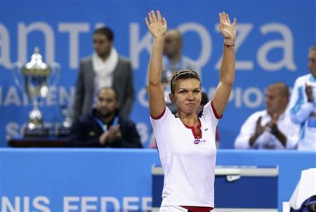 Simona Halep of Romania celebrates defeating Samantha Stosur of Australia during the WTA Tournament of Champions final match in Sofia November 3, 2013. REUTERS/Stoyan Nenov