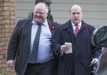 Toronto Mayor Rob Ford leaves his mother's house with his Chief of Staff Earl Provost (R) in Toronto, November 1, 2013. REUTERS/Mark Blinch