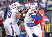 Nov 3, 2013; Orchard Park, NY, USA; Buffalo Bills quarterback Jeff Tuel (7) is chased from the pocket by the Kansas City Chiefs defense during the second half at Ralph Wilson Stadium. Chiefs beat the Bills 23-13. Mandatory Credit: Kevin Hoffman-USA TODAY Sports
