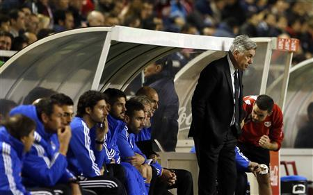 Real Madrid's coach Carlo Ancelotti (standing) reacts during their Spanish first division soccer match against Rayo Vallecano at Vallecas stadium in Madrid November 2, 2013. REUTERS/Susana Vera
