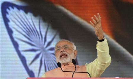 Gujarat's chief minister and Hindu nationalist Narendra Modi, the prime ministerial candidate for India's main opposition Bharatiya Janata Party (BJP) addresses a rally in the eastern Indian city of Patna October 27, 2013. REUTERS/Krishna Murari Kishan