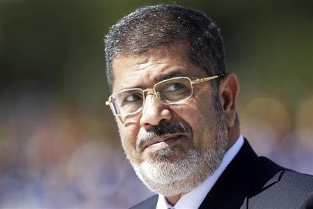 Egypt's President Mohamed Mursi reviews the troops in an official ceremony before a meeting with Brazil's President Dilma Rousseff at the Planalto Palace in Brasilia May 8, 2013 file photo. REUTERS/Ueslei Marcelino