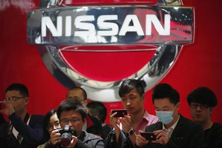 People take pictures of Nissan cars during the 15th Shanghai International Automobile Industry Exhibition in Shanghai April 21, 2013. REUTERS/Carlos Barria