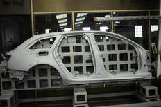 A pressed steel car part is seen at the factory of Troqueleria Del Norte, die-manufacturers for the automotive sector, in Sondika, 12 km (7 miles) from Bilbao May 9, 2013. REUTERS/Vincent West