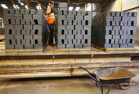 A worker checks the quality of bricks at the Wienerberger Brick Factory in Dosthill, central England August 8, 2013. REUTERS/Darren Staples