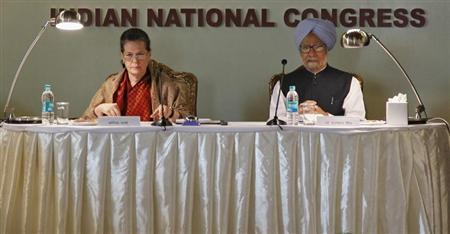 India's Prime Minister Manmohan Singh (R) and Chief of India's ruling Congress party Sonia Gandhi attend the Indian National Congress meeting at Surajkund on the outskirts of New Delhi November 9, 2012. REUTERS/B Mathur