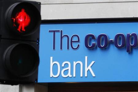 A red crossing light is pictured next to a branch of the Co-operative Bank in London October 21, 2013. REUTERS/Luke MacGregor