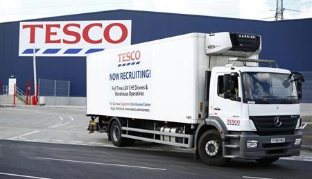 A lorry with job advertisements on its side leaves a Tesco distribution centre in Dagenham, east London August 12, 2013. REUTERS/Andrew Winning