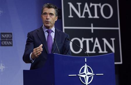 NATO Secretary-General Anders Fogh Rasmussen holds a news conference during a NATO defence ministers meeting at the Alliance headquarters in Brussels October 23, 2013. REUTERS/Yves Herman