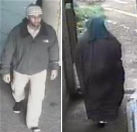 Mohammed Ahmed Mohamed, who is subject to a terrorism prevention and investigation measures (TPim) notice, is seen entering (L) and leaving a mosque in Acton, west London in this undated still image taken from video, received via the Metropolitan Police in London on November 4, 2013. REUTERS/Metropolitan Police/Handout via Reuters