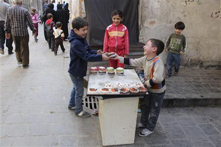 A child sells cake in Old Aleppo, November 3, 2013. REUTERS/Molhem Barakat
