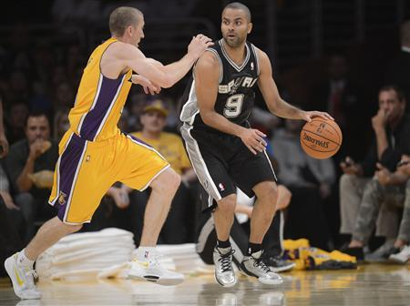 Los Angeles, CA, USA; San Antonio Spurs point guard Tony Parker (9) controls the ball against the defense of Los Angeles Lakers point guard Steve Blake (5) during the first half at Staples Center. Mandatory Credit: Gary A. Vasquez-USA TODAY Sports