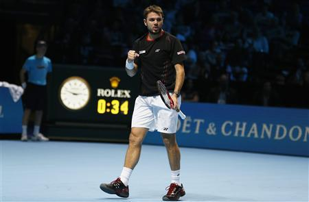 Stanislas Wawrinka of Switzerland celebrates breaking serve in the first set during his men's singles tennis match against Tomas Berdych of the Czech Republic at the ATP World Tour Finals at the O2 Arena in London November 4, 2013. REUTERS/Suzanne Plunkett