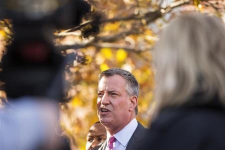 Democratic New York City mayoral candidate Bill de Blasio speaks to the media outside a campaign stop in New York, November 4, 2013. REUTERS/Lucas Jackson