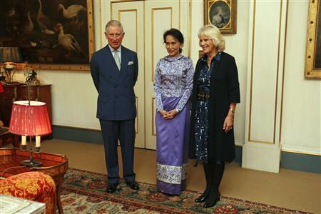 Britain's Prince Charles and his wife Camilla, Duchess of Cornwall welcome Myanmar pro-democracy leader Aung San Suu Kyi (C) to Clarence House in London October 23, 2013. REUTERS/Tal Cohen/pool