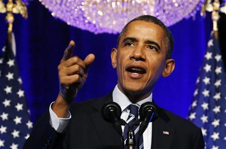 U.S. President Barack Obama gestures as he delivers remarks on the Affordable Care Act, commonly known as Obamacare, at an Organizing for Action grassroots supporter event in Washington, November 4, 2013. REUTERS/Jonathan Ernst