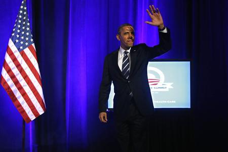 U.S. President Barack Obama takes the stage to deliver remarks on the Affordable Care Act, commonly known as Obamacare, at an Organizing for Action grassroots supporter event in Washington, November 4, 2013. REUTERS/Jonathan Ernst