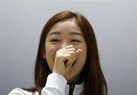 South Korean figure skater Kim Yuna smiles as she listens to questions during a news conference ahead of Sochi 2014 Winter Olympics, at the Taereung National Training Center in Seoul October 30, 2013. REUTERS/Kim Hong-Ji