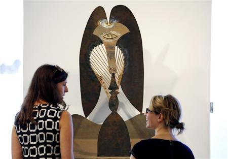 Christie's employees Lauren Peterson (R) and Sheri Farber stand in front of ''Tete (Maquette pour la sculpture en plein air du Chicago Civic Center)'' (Model for the outdoor sculpture at the Chicago Civic Center), a model used for his public sculpture, is seen at a viewing in Chicago, Illinois, October 2, 2013. REUTERS/Jim Young