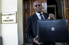 Zimbabwe's Patrick Chinamasa holds up a briefcase containing the government's budget at the Parliament buildings in Harare, January 29, 2009. REUTERS/Philimon Bulawayo