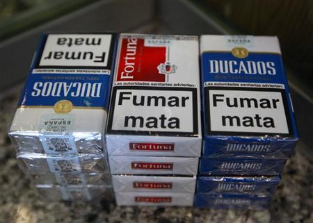 Cigarette packs of Imperial Tobacco are pictured at a tobacco store in Madrid June 13, 2011. REUTERS/Andrea Comas