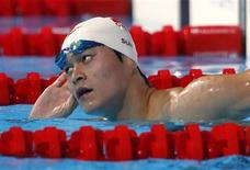 China's Sun Yang reacts after the men's 1500m freestyle heats during the World Swimming Championships at the Sant Jordi arena in Barcelona in this August 3, 2013 file photo. REUTERS/Michael Dalder/Files